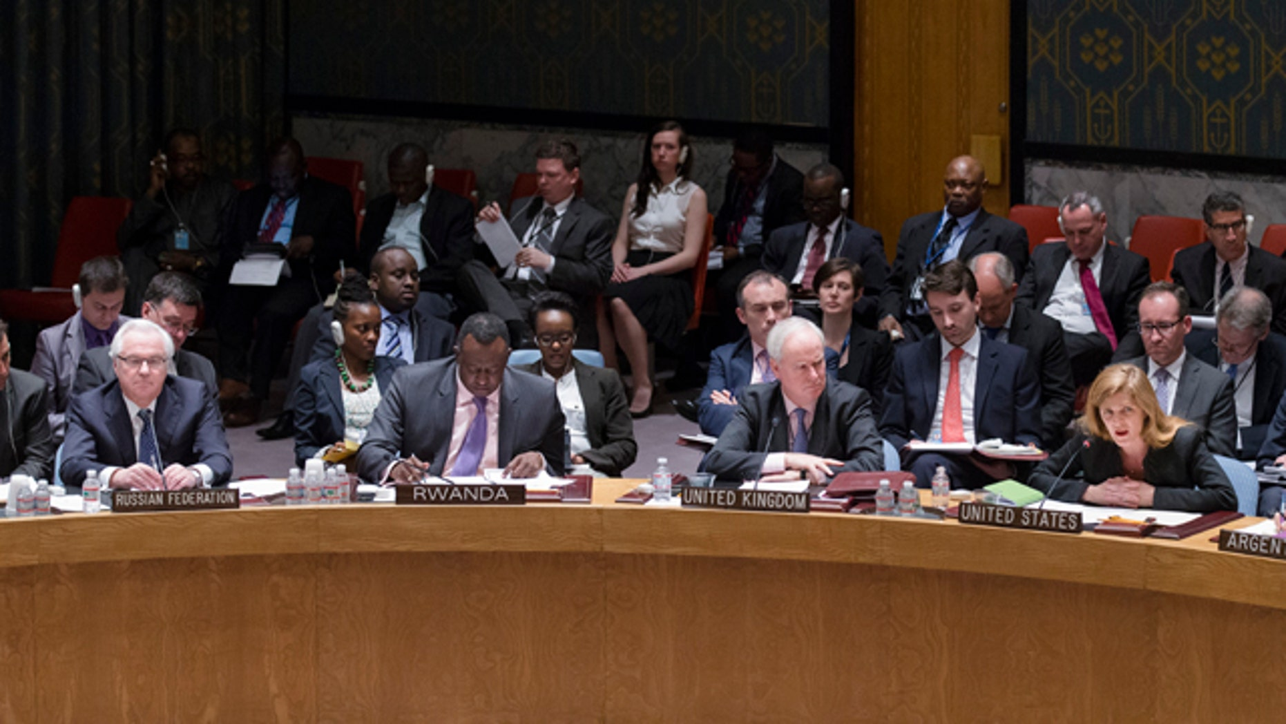April 13, 2014: Samantha Power, the United States ambassador to the United Nations, right, speaks alongside Mark Lyall Grant, the United Kingdom's ambassador to the United Nations, center right, Eugene Richard Gasana, Rwanda's ambassador to the United Nations, center left, and Vitaly Churkin, the Russian Federation's ambassador to the United Nations, left, during an U.N. Security Council emergency meeting called at Russia's request to discuss the growing crisis in Ukraine.  (AP Photo/John Minchillo)