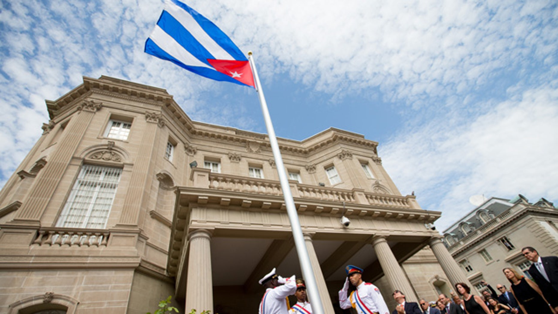 FILE- In this July 20, 2015, file photo, Cuban Foreign Minister Bruno Rodriguez, right of center, applauds with other dignitaries after raising the Cuban flag over their new embassy in Washington. (AP Photo/Andrew Harnik, Pool, File)