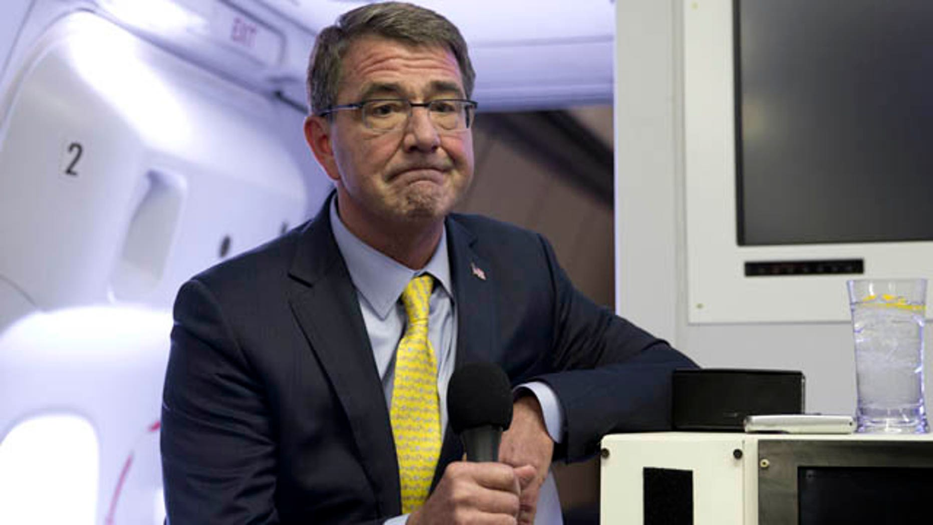 FILE - In this Wednesday, July 22, 2015, file photo, U.S. Defense Secretary Ash Carter pauses as he speaks with media on a military aircraft after departing Jiddah, Saudi Arabia, en route to Amman, Jordan. (AP Photo/Carolyn Kaster, Pool, File)