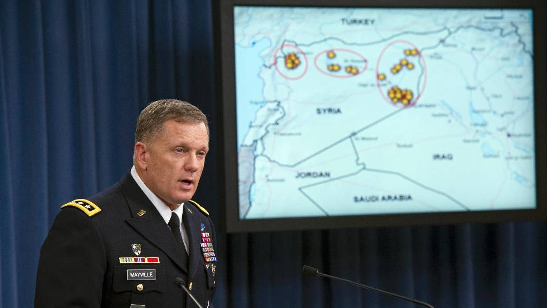 FILE - In this Tuesday, Sept. 23, 2014, file photo,  Army Lt. Gen. William Mayville, Jr., Director of Operations J3, speaks about the operations in Syria during a news conference at the Pentagon. According to current and former U.S. officials, the Pentagon is grappling with significant intelligence gaps as it bombs Iraq and Syria, and it is operating under less restrictive targeting rules than those President Barack Obama imposed on the CIA drone campaign in Pakistan and Yemen. (AP Photo/Cliff Owen, File)