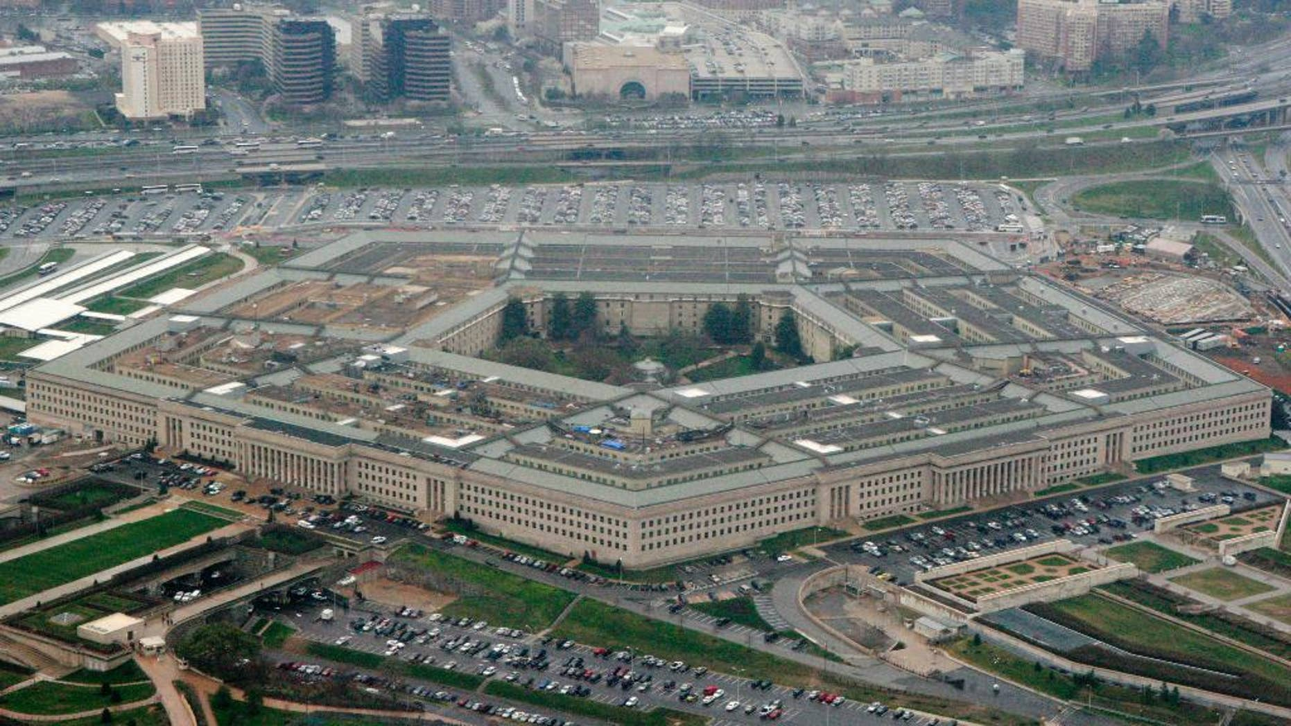 "FILE - This March 27, 2008, aerial file photo shows the Pentagon in Washington. The U.S. is protesting an intercept of a U.S. reconnaissance plane by a Russian fighter jet last week, calling it ""unsafe and unprofessional"" amid what it views as increasingly aggressive air operations by Moscow. Pentagon spokesman Mark Wright on Sunday, April 12, 2015, said the U.S. was filing a complaint to Russia after the April 7 incident over the Baltic Sea. (AP Photo/Charles Dharapak, File)"