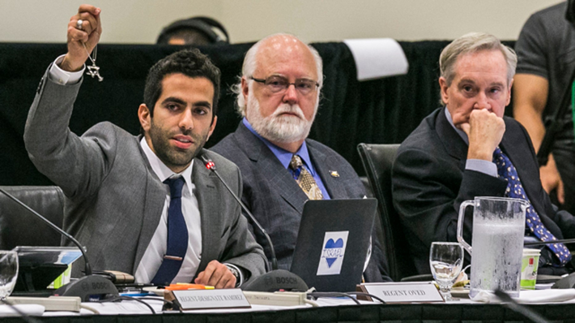 Sept. 17, 2015: University of Californias Student Regent, Abraham Oved, left, holds up a Star of David as he addresses the UC Irvine Board of Regents meeting at the UC Irvine Student Center to discuss a controversial policy statement on intolerance at the campus in Irvine, Calif. (AP Photo/Damian Dovarganes)