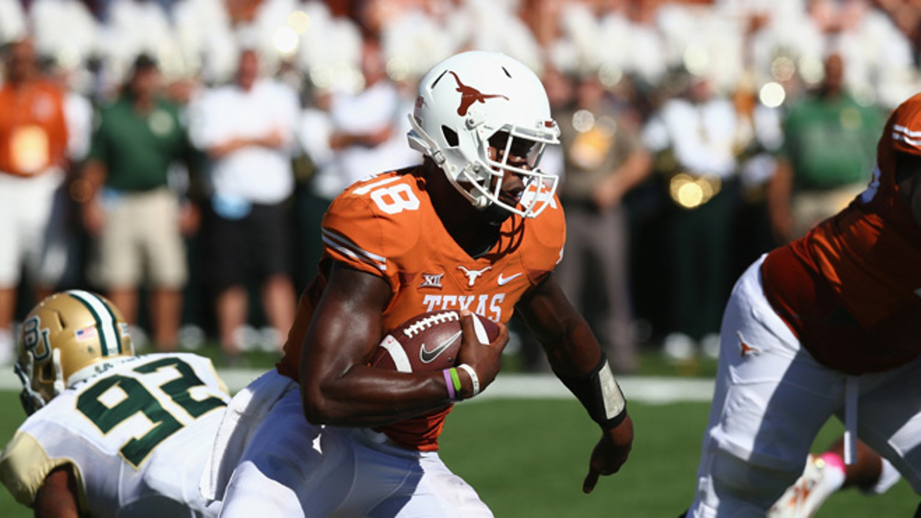 AUSTIN, TX - OCTOBER 04:  Tyrone Swoopes #18 of the Texas Longhorns runs the ball against the Baylor Bears at Darrell K Royal-Texas Memorial Stadium on October 4, 2014 in Austin, Texas.  (Photo by Ronald Martinez/Getty Images)