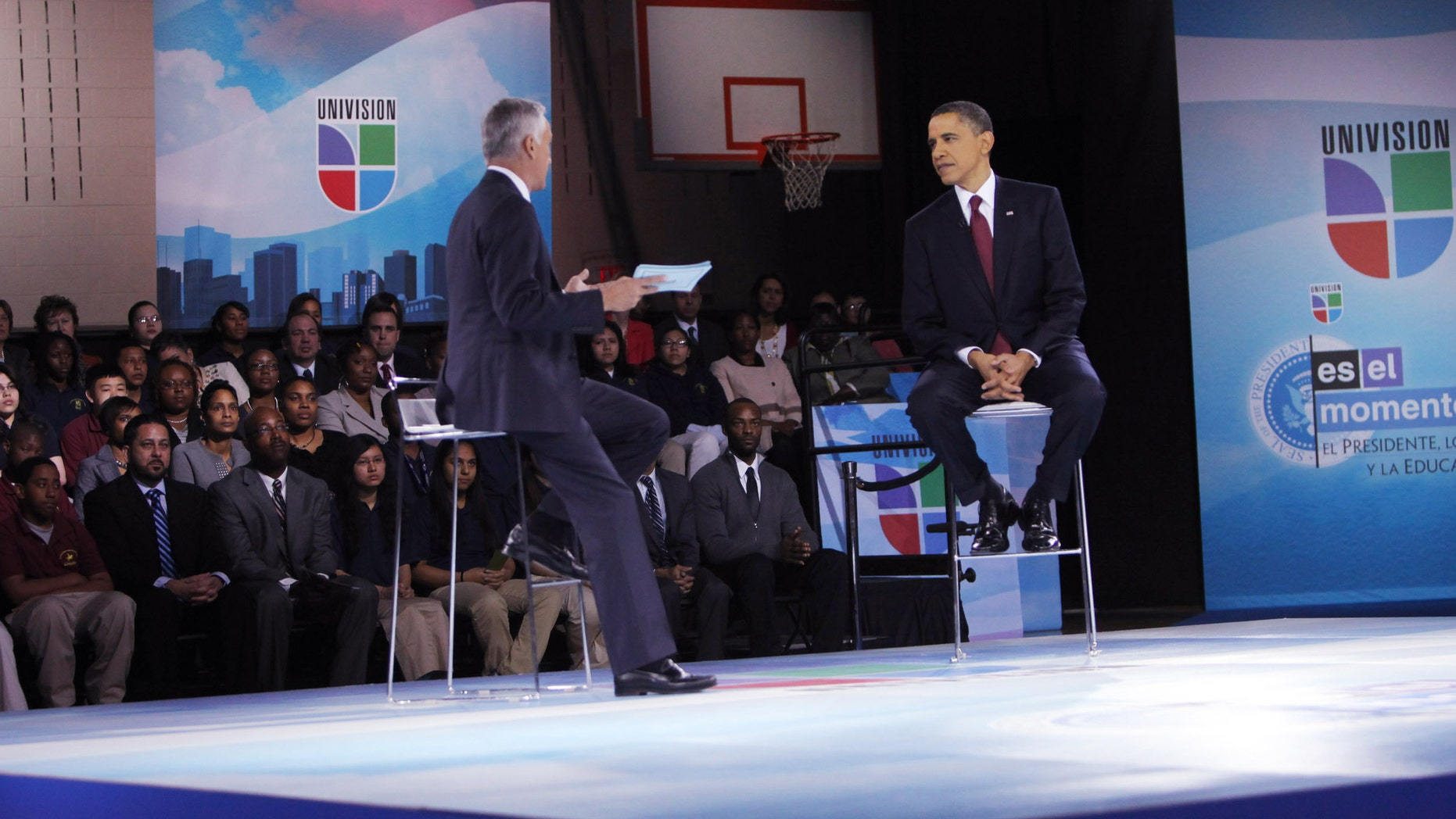 WASHINGTON - MARCH 28:  U.S. President Barack Obama (R) and moderator Jorge Ramos participate in an education town hall hosted by Univision at Bell Multicultural High School, Washington, DC. Obama is set to speak to the nation in the evening about the U.S. role in Libya.   (Photo by Dennis Brack-Pool/Getty Images)