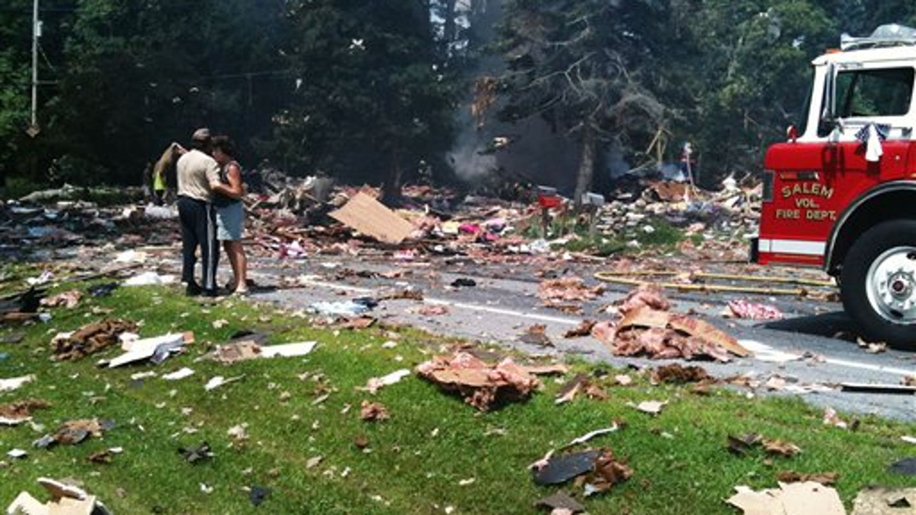 July 13: Landlords David and Linda Baldwin embrace amid the debris of their rental home after it exploded on Route 29 1/2 mile west of the intersection with Route 22 in Salem, N.Y.
