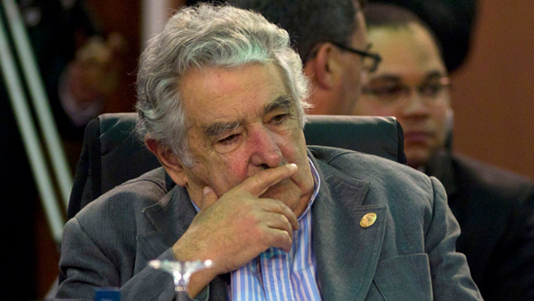 FILE -  In this Dec. 3, 2011 file photo, Uruguay's President Jose Mujica attends a working session of the Community of Latin American and Caribbean States, CELAC, summit in Caracas, Venezuela.  Uruguay's president has canceled his trip Thursday, Nov. 15, 2012, to the Ibero-American Summit in Spain, saying doctors have ordered bed rest after a painful blood clot was found in his lower right leg. The 77-year-old Jose Mujica says the clot was found with a sonogram and that he's following doctors' orders to relax at home for two or three days while taking anti-coagulant medicine. (AP Photo/Ariana Cubillos, File)