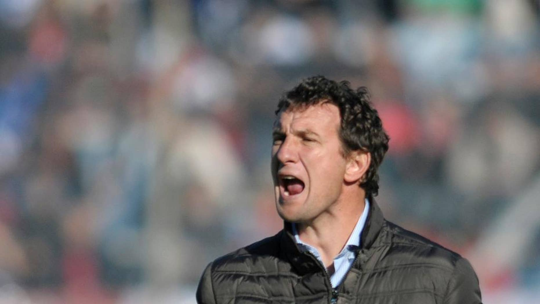 FILE - In this Aug. 4, 2013 file photo, coach of Uruguay's Nacional soccer team, Rodolfo Arruabarrena, yells from the sidelines of a friendly soccer game against Spain's Atletico de Madrid in Montevideo, Uruguay. Arruabarrena became the new coach for Argentina's Boca Juniors, replacing fired coach Carlos Bianchi, announced Friday, Aug. 29, 2014 by the club on their official website. (AP Photo/Matilde Campodonico, File)