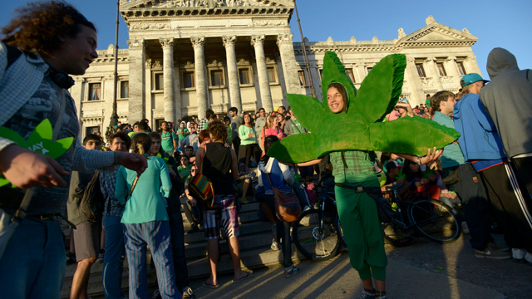 Dec. 10, 2013: People attend a demonstration in support of the legalization of marijuana outside the Congress in Montevideo, Uruguay.