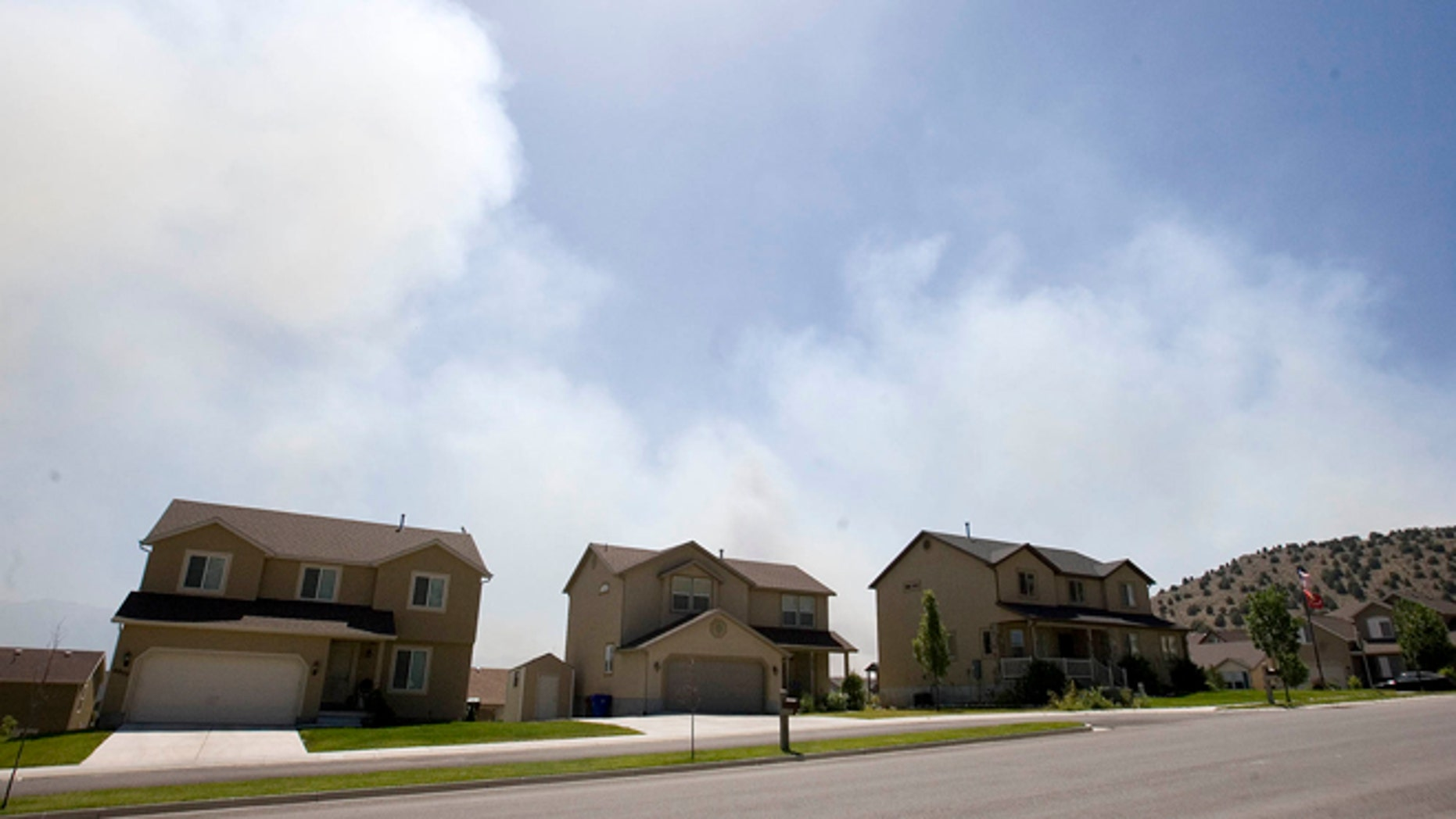 June 22, 2012: Smoke fills the sky as a fire burns near Eagle Mountain, Utah.