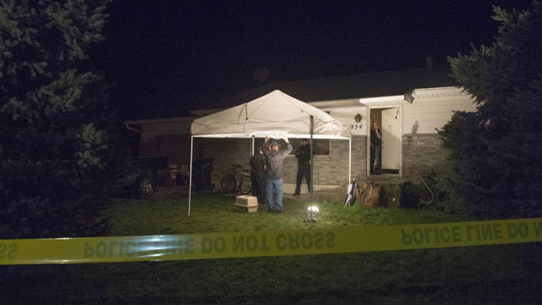 September 27, 2014: Springville Police investigate the scene where five people were found dead in a home in Utah. (AP Photo/The Salt Lake Tribune, Rick Egan)