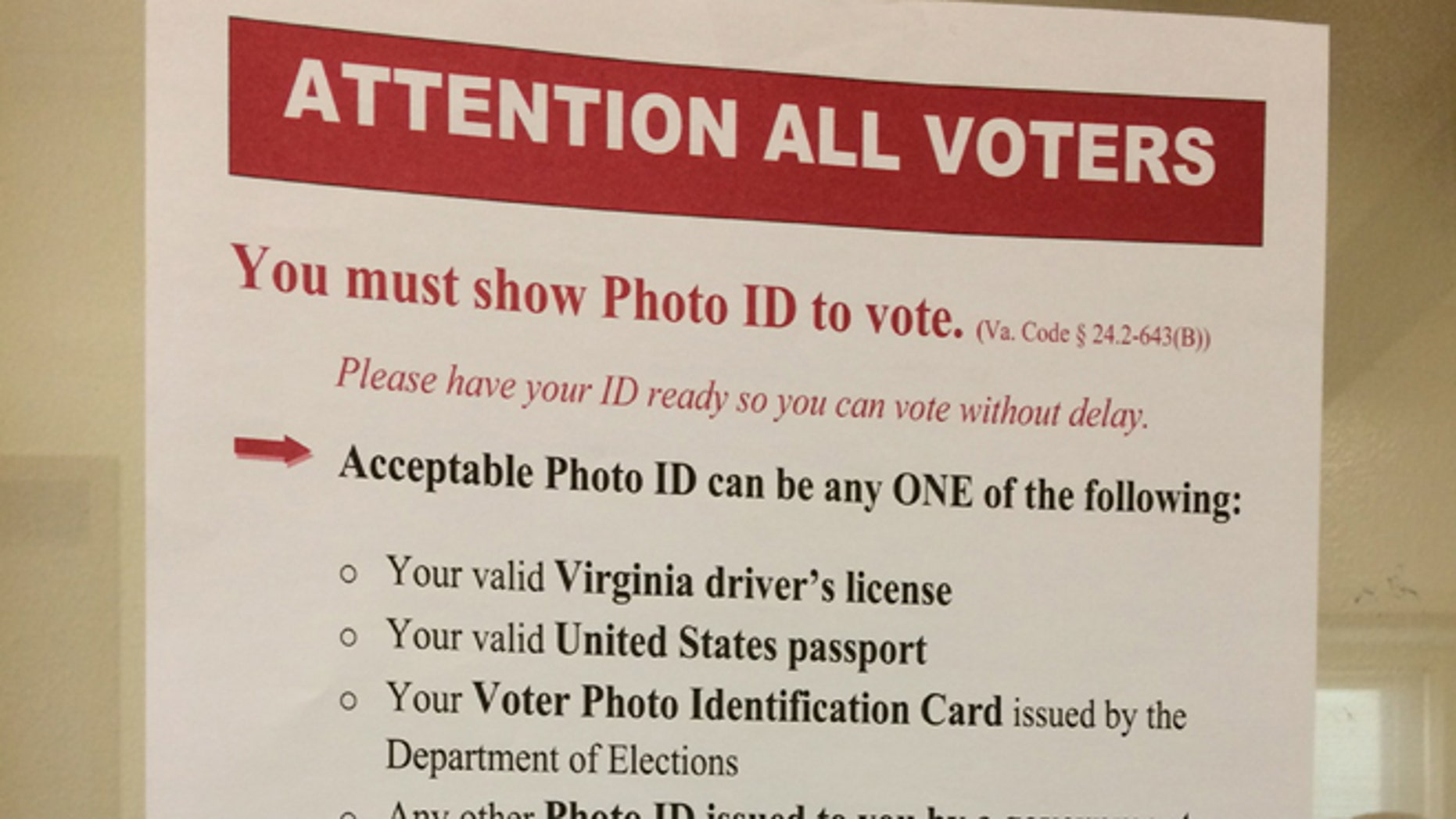 The new state rules are posted prominently at the Lee Center in Alexandria, Va., where the state began checking photo identification for registered voters on Tuesday, Nov. 4, 2014. (Julie Moos/McClatchyDC)