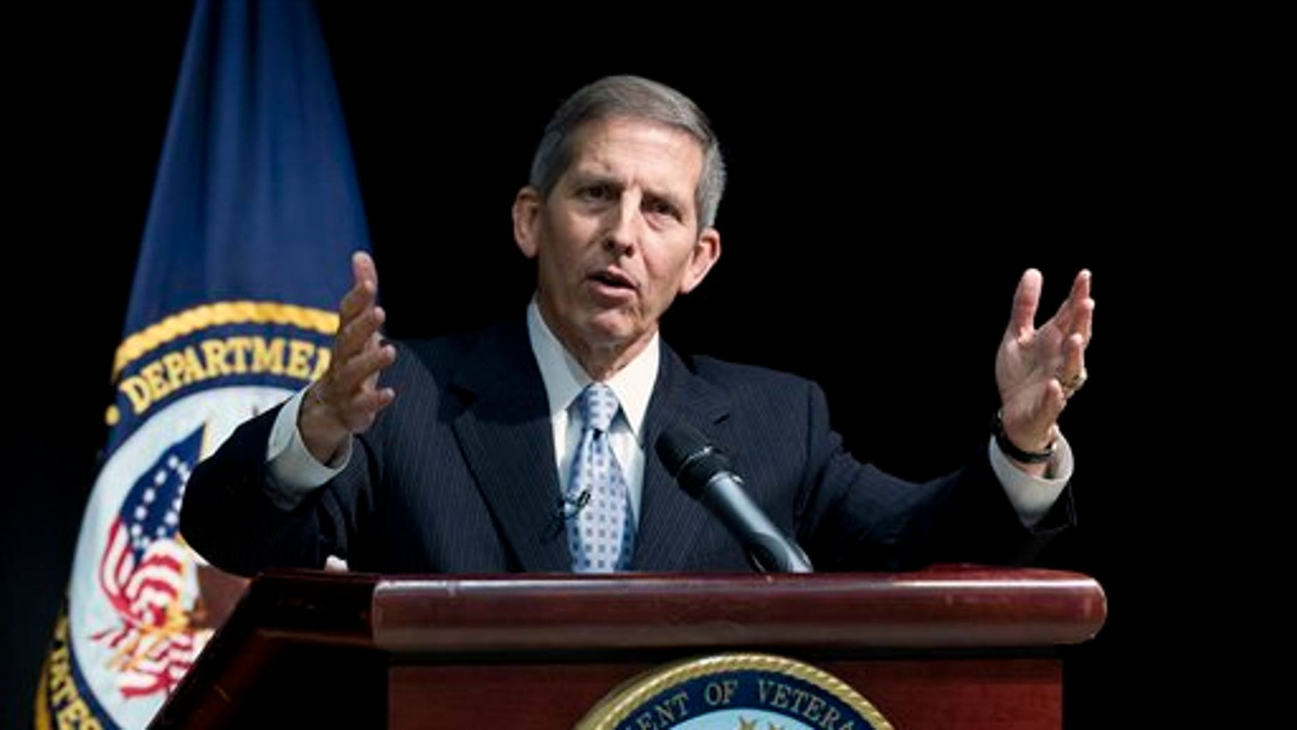 Acting Veterans Affairs Secretary Sloan Gibson speaks during a news conference at the VA Medical Center in Washington, Wednesday, June 18, 2014. The Veterans Affairs Department (VA) release the results from its Nationwide Access Audit, along with facility level patient access data for all Veterans health facilities. (AP Photo/Jose Luis Magana)