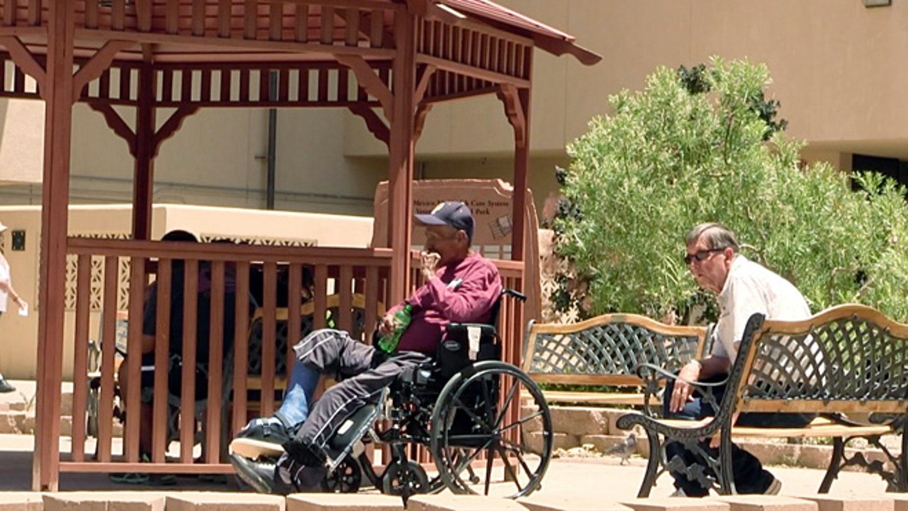 July 3, 2014: Men sit outside the Raymond G. Murphy VA Medical Center in Albuquerque, N.M..