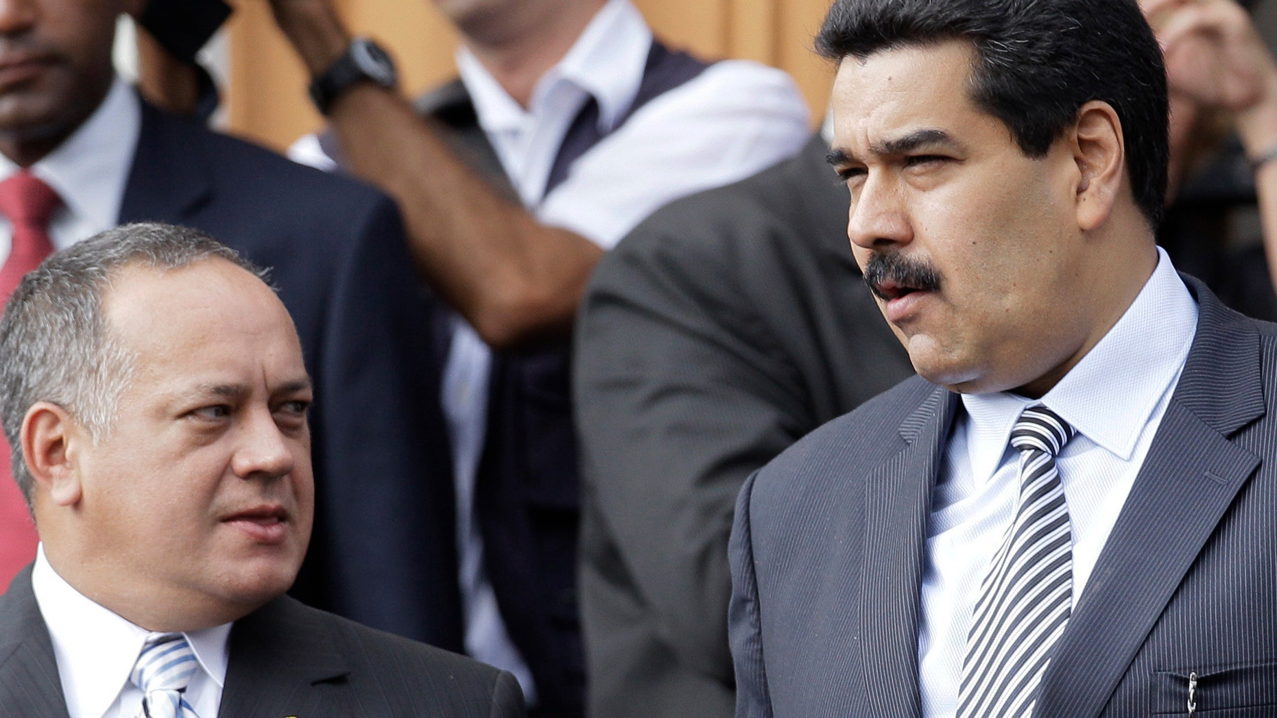Venezuelan Vice President Nicolas Maduro, right, and President of the National Assembly Diosdado Cabello, attend a ceremony for the 182 anniversary of the death of Simon Bolivar in Caracas, December 17, 2012. (AP Photo / Ariana Cubillos)