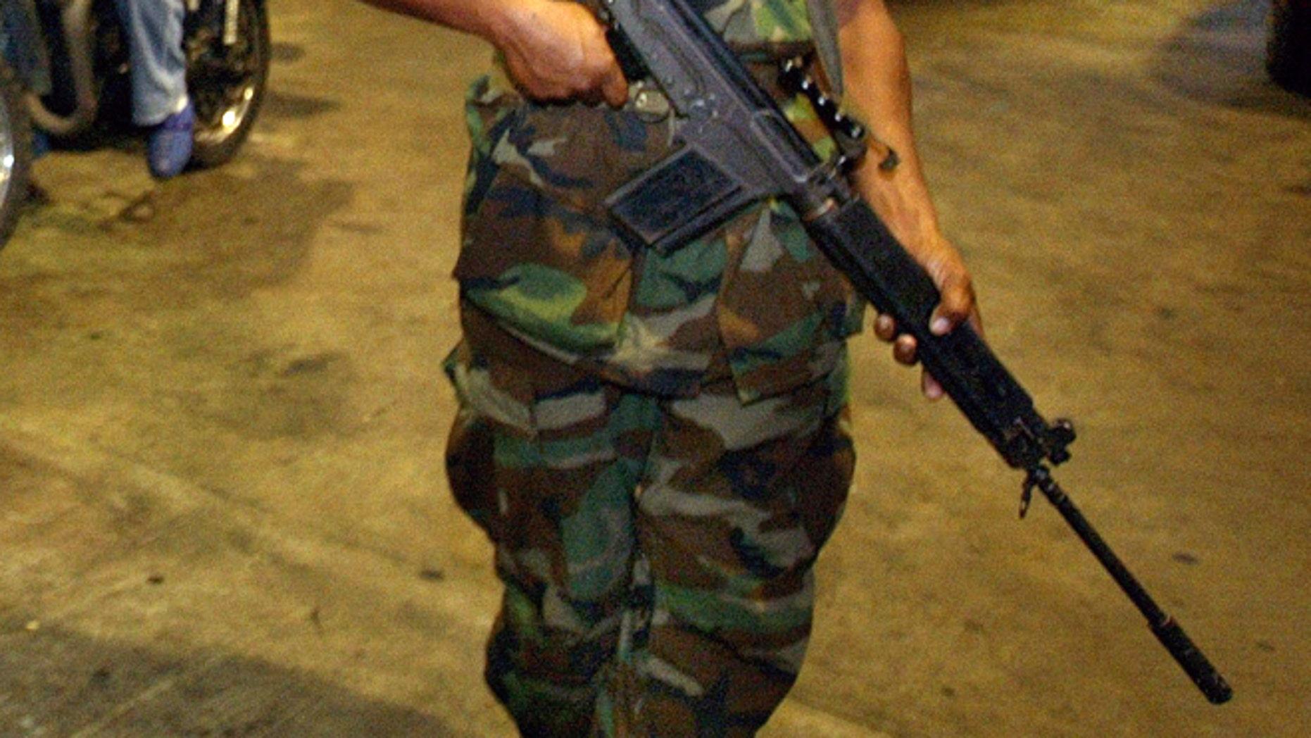 A Venezuelan soldier. (Photo by Paula Bronstein/Getty Images)