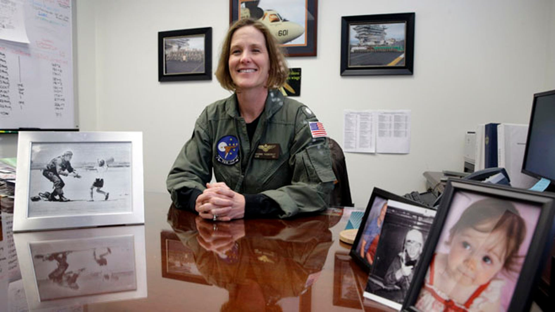 Jan. 9, 2014: This photo shows U.S. Navy Commander Valerie Overstreet poses in her office on the U.S. Naval Academy campus in Annapolis, Md.