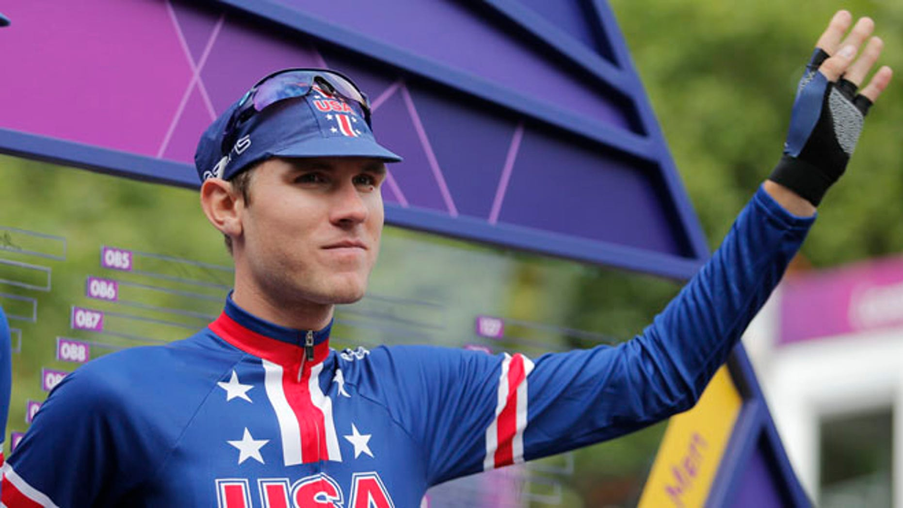 FILE - In this July 28, 2012, file photo, U.S. cyclist Tejay van Garderen, right, is flanked by Taylor Phinney as he waves before the the Men's Road Cycling race at the 2012 Summer Olympics, in London. American cyclist Tejay van Garderen has withdrawn his name from consideration for the Rio Olympics amid concerns that he may contract the Zika virus and pass it along to his pregnant wife. (AP Photo/Christophe Ena, File)