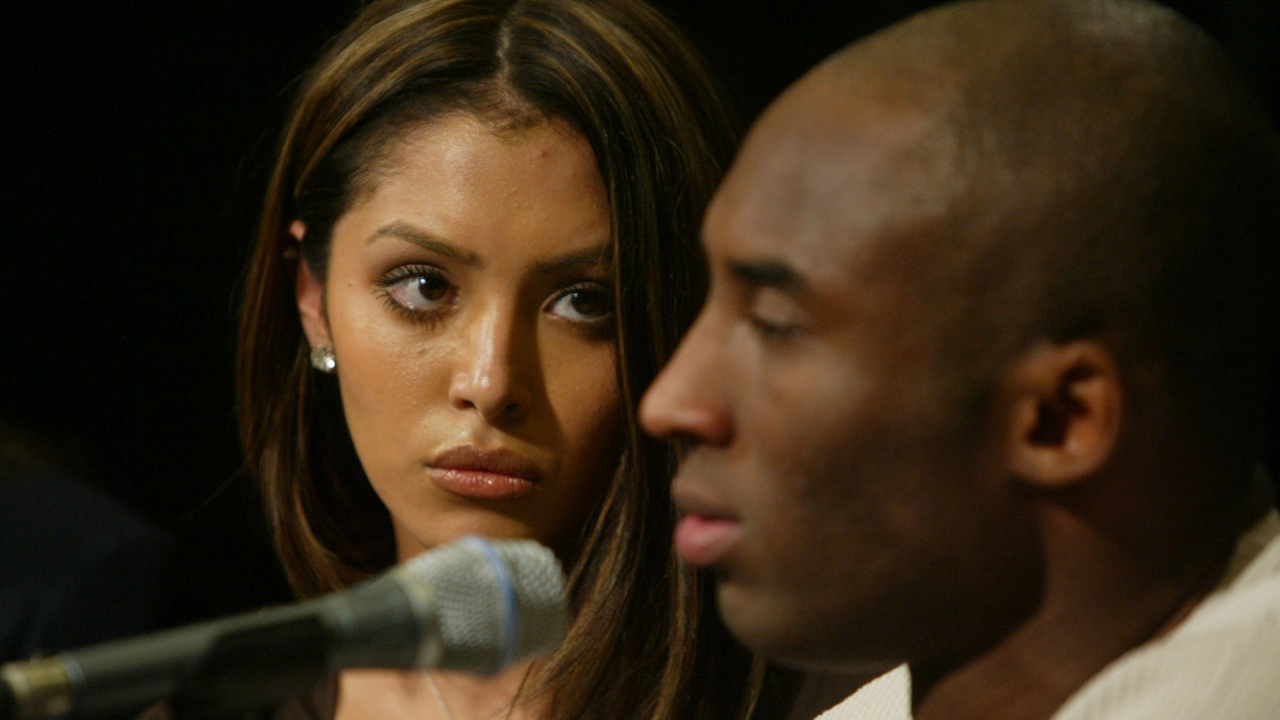 FILE PHOTO: July 18, 2003:  Vanessa Laine, wife of NBA star Kobe Bryant, listens during a press conference at Staples Center, the home of the Los Angeles Lakers, in Los Angeles, CA.  In the press conference, the NBA star claimed he is innocent of the sexual assault charges filed  by the District attorney of  Eagle, Colorado for the alleged rape of  a 19-year-old Colorado Woman.