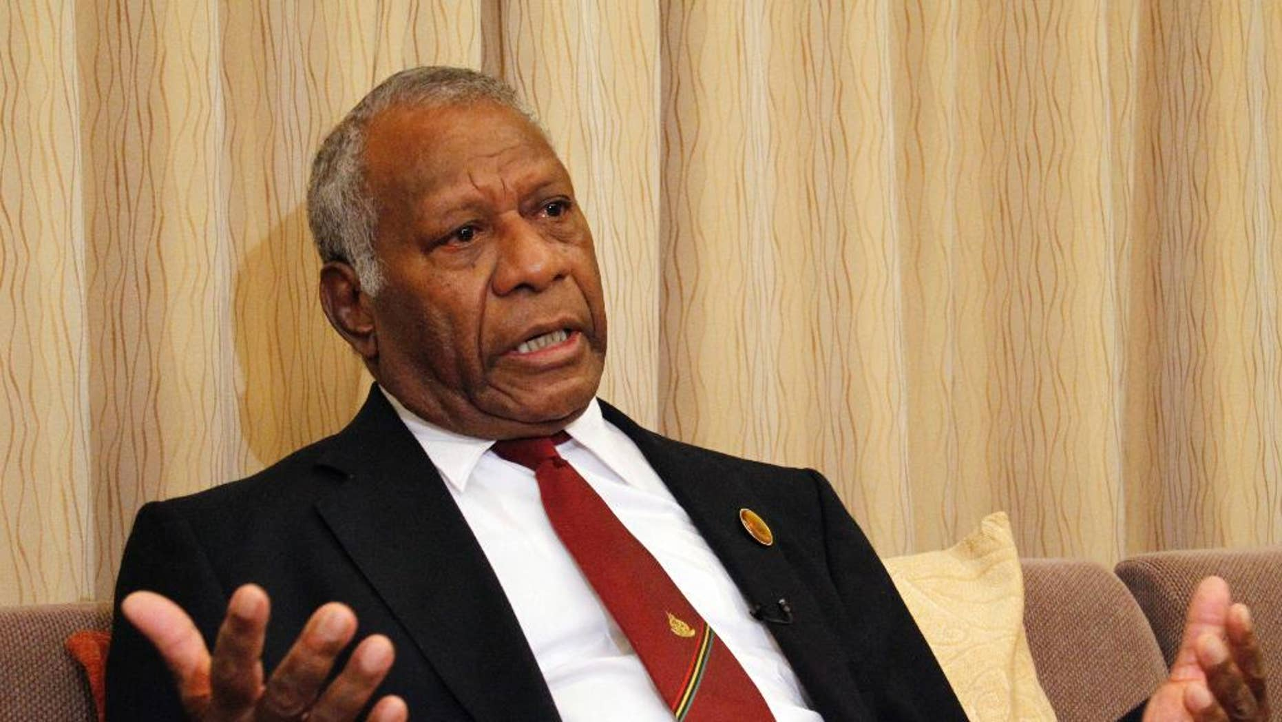 """FILE - In this March 16, 2015 file photo, Vanuatu President Baldwin Lonsdale speaks during an interview in his hotel room in Sendai, Miyagi prefecture, northeastern Japan while attending a U.N. conference on disaster risk reduction. The South Pacific island nation of Vanuatu found itself in political chaos Tuesday, Oct. 13 following an extraordinary few days in which 14 lawmakers were found guilty of corruption but were then pardoned by one of their own while the president was abroad. The events have created a constitutional crisis for Lonsdale, who promised he would find a legal avenue to """"clean up the mess."""" (AP Photo/Koji Ueda, File)"""