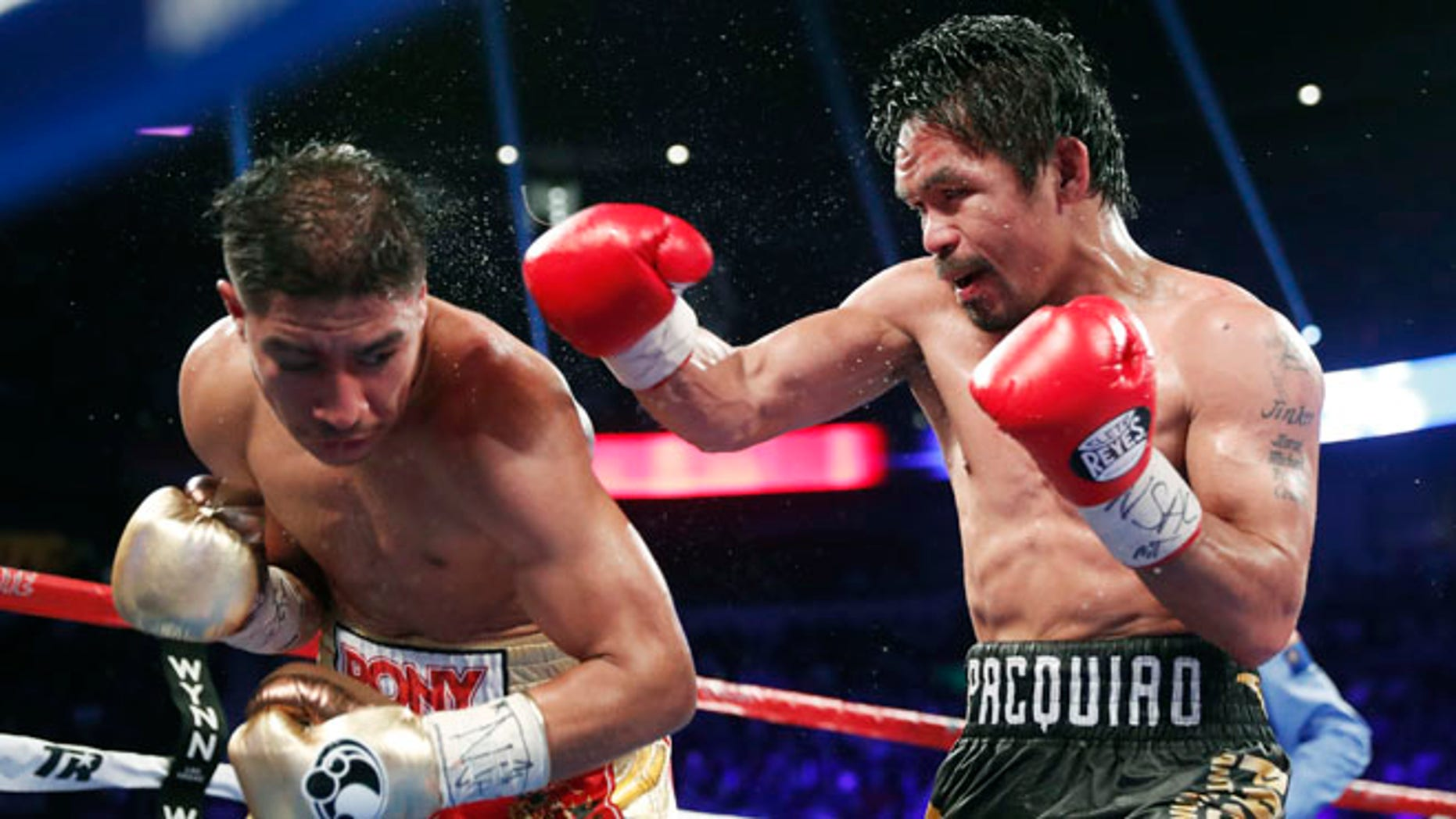 Jessie Vargas, left, tries to avoid a punch from Manny Pacquiao, of the Philippines, during their WBO welterweight title boxing match, Saturday, Nov. 5, 2016, in Las Vegas. (AP Photo/Isaac Brekken)