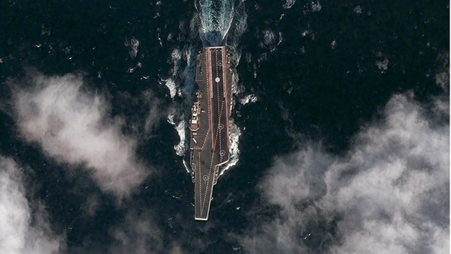 Dec. 8, 2011: A satellite image shows the Chinese aircraft carrier Varyag sailing in the Yellow Sea -- the country's first such vessel.