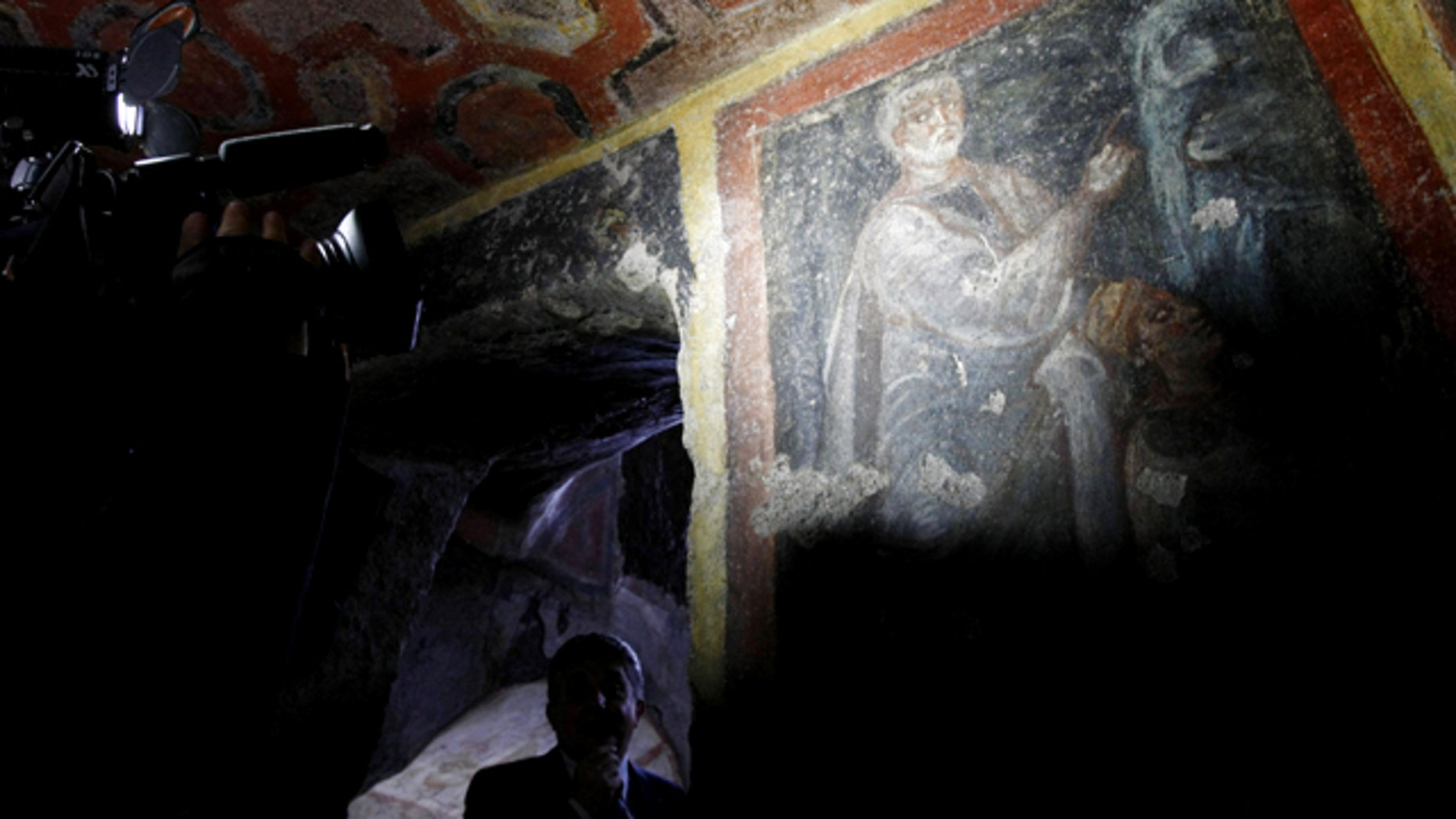 June 22: A cameraman films a painting discovered with the earliest known icons of the Apostles Peter and Paul in a catacomb located under a modern office building in Rome.