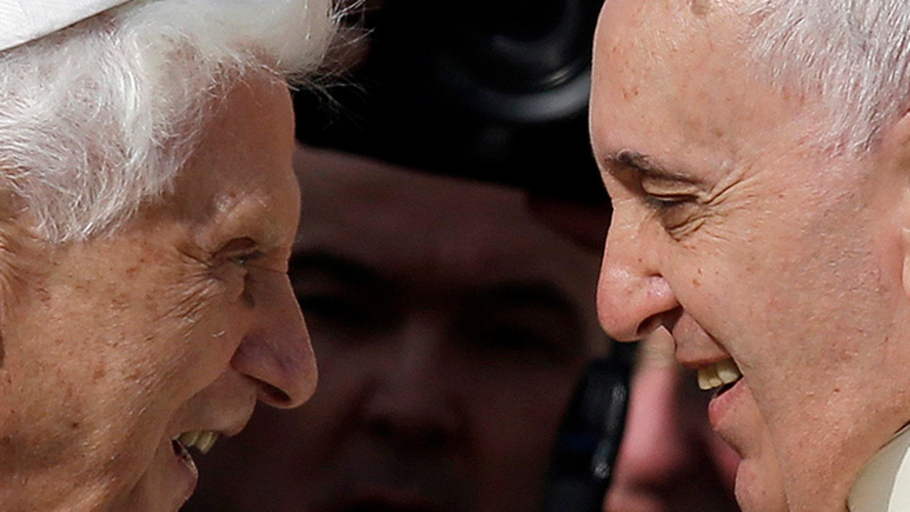 Pope Emeritus Benedict XVI and Pope Francis on Sept. 28, 2014.