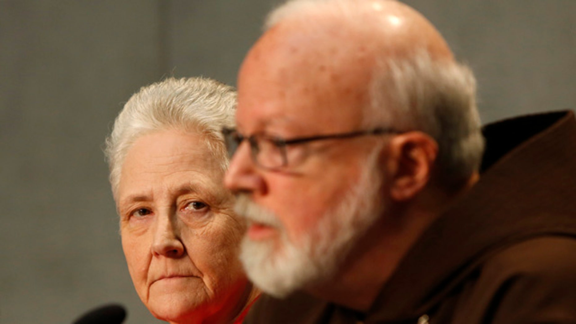 May 3, 2014: Cardinal Sean O'Malley, the archbishop of Boston, right, and Marie Collins attend a press conference at the Vatican. Members of Pope Francis' sexual abuse advisory board say they will develop specific protocols to hold bishops and other church authorities accountable if they fail to report suspected abuse or protect children from pedophile priests. (AP Photo/Riccardo De Luca)