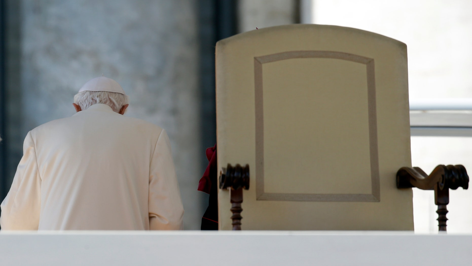 Feb. 27, 2013 FILE photo shows Pope Benedict XVI leaving after celebrating his last general audience, in St. Peter's Square, at the Vatican.