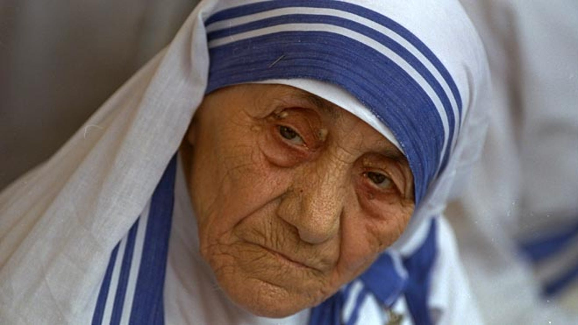 FILE - In this Aug. 25, 1993 file photo Mother Teresa, head of Missionaries of Charity, is photographed, in New Delhi,  India. Pope Francis has signed off on the miracle needed to make Mother Teresa a saint, giving the nun who cared for the poorest of the poor one of the Catholic Church's highest honors just two decades after her death. The Vatican said Friday, Dec. 18, 2015, that Francis approved a decree attributing a miracle to Mother Teresa's intercession during an audience with the head of the Vatican's saint-making office on Thursday, his 79th birthday. (AP Photo, file)