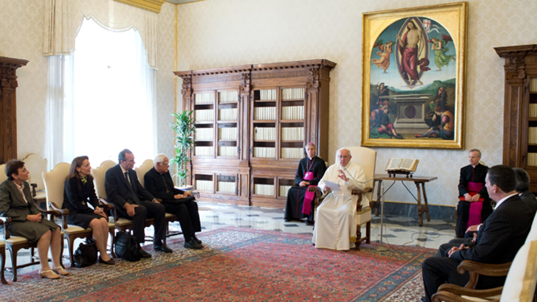 """In this photo released by Vatican newspaper L'Osservatore Romano, Pope Francis meets members of the International Catholic Child Bureau, at the Vatican Friday, April 11, 2014. Pope Francis asked for forgiveness Friday from people who were sexually abused by priests, and vowed that there will be no going back in the church's fight to protect children. Francis made the off-the-cuff remarks after coming under criticism from victims' advocacy groups for a perceived lack of attention to the problem and ongoing demands that he sanction bishops who covered up for pedophiles. In his remarks to members of the International Catholic Child Bureau, a French Catholic network of organizations that protects children's rights, Francis said he felt """"called to take it upon myself"""" and """"ask forgiveness"""" for the evil that some priests had committed against children. """"The church is aware of this damage,"""" he was quoted as saying by Vatican Radio.  (AP Photo/L'Osservatore Romano)"""