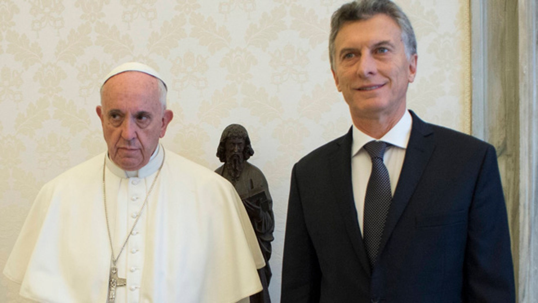 Pope Francis and Argentina's president Mauricio Macri pose for a picture during a private audience at the Vatican, Saturday, Feb. 27, 2016 (L'Osservatore Romano/pool photo via AP)