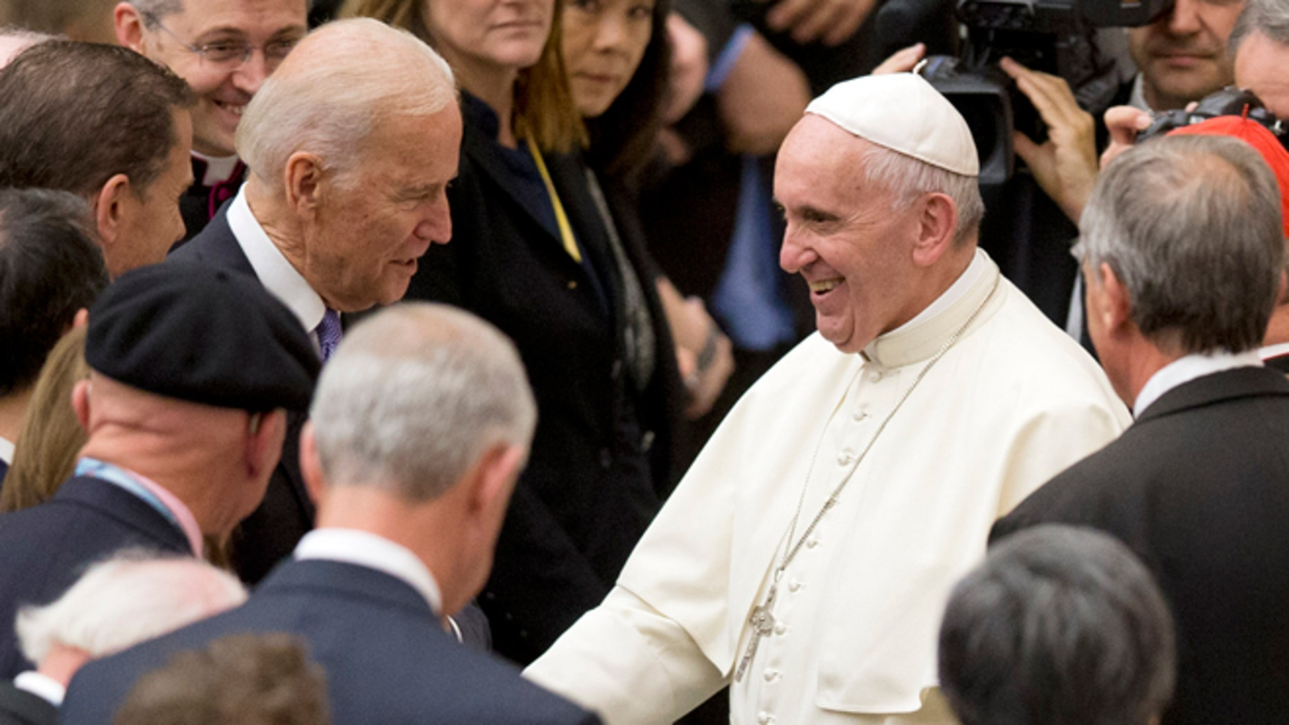 Pope Francis shakes hands with US vice president Joe Biden as he takes part at a congress on the progress of regenerative medicine and its cultural impact, being held in the Pope Paul VI hall at the Vatican,  Friday, April 29, 2016. (AP Photo/Andrew Medichini)