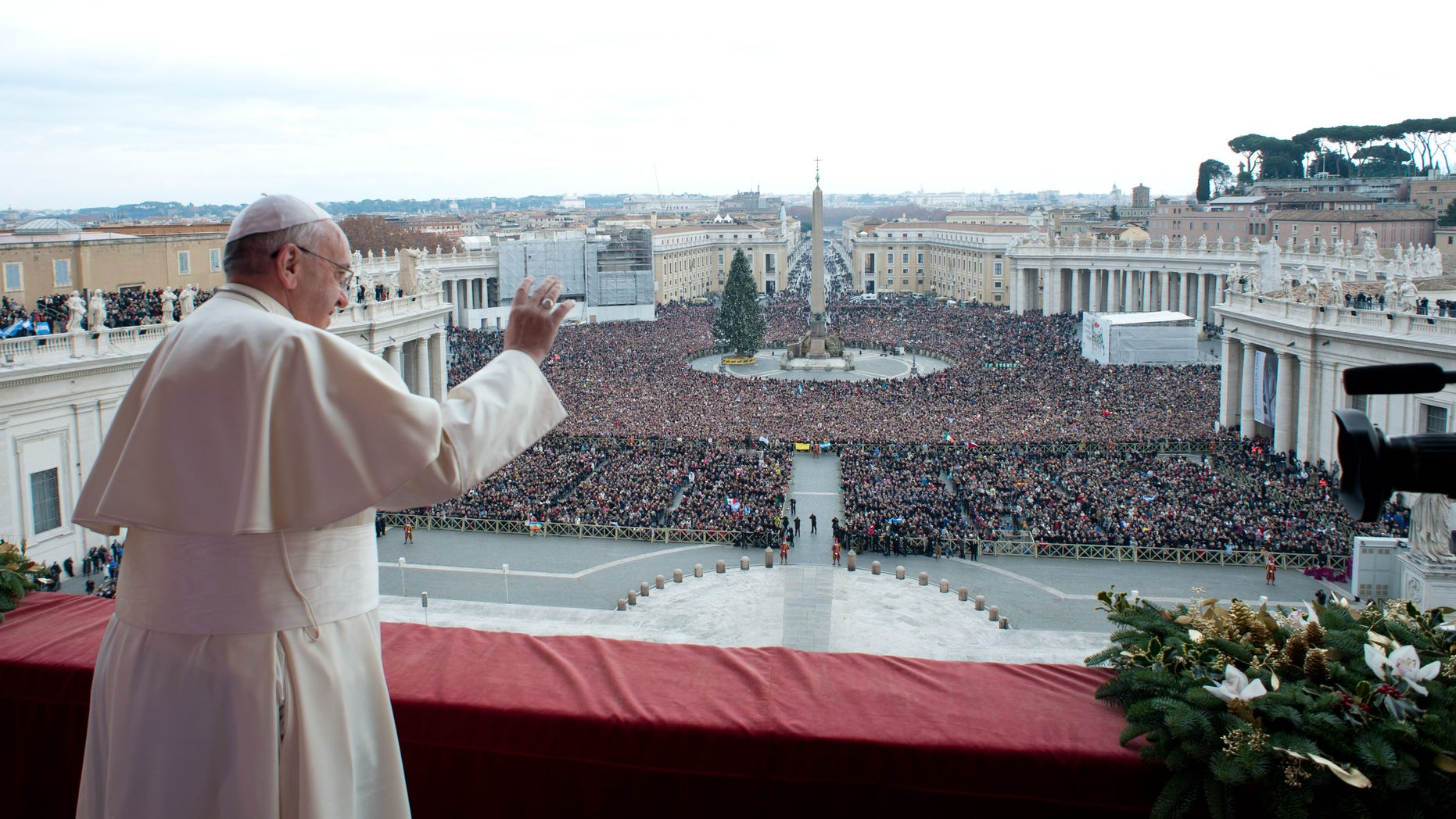 """Dec. 25, 2013: In this picture provided by the Vatican newspaper L'Osservatore Romano, Pope Francis delivers his """"Urbi et Orbi"""" (to the City and to the World) message from the central balcony of St. Peter's Basilica at the Vatican."""