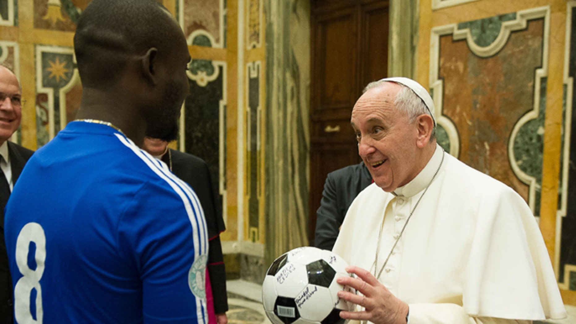 """Pope Francis meets with participants of the meeting organized by the Pontifical Council """" Cor Unum """" and the Pontifical Commission for Latin America on the fifth anniversary of the Haiti's earthquake during a private audience at the Vatican, Saturday, Jan. 10, 2015. (AP Photo/L'Osservatore Romano, Pool)"""