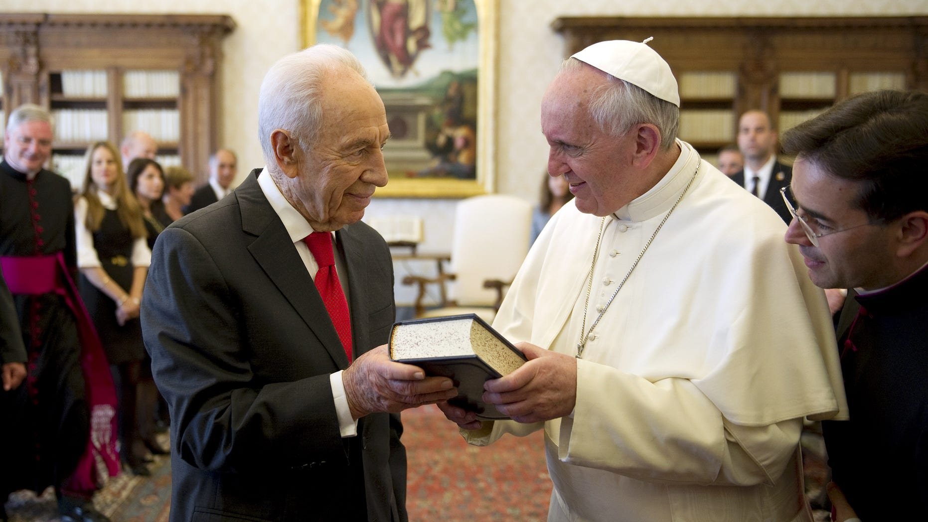 April 30, 2013: Pope Francis, right, exchanges gifts with Israeli President Shimon Peres on the occasion of their private audience, at the Vatican.