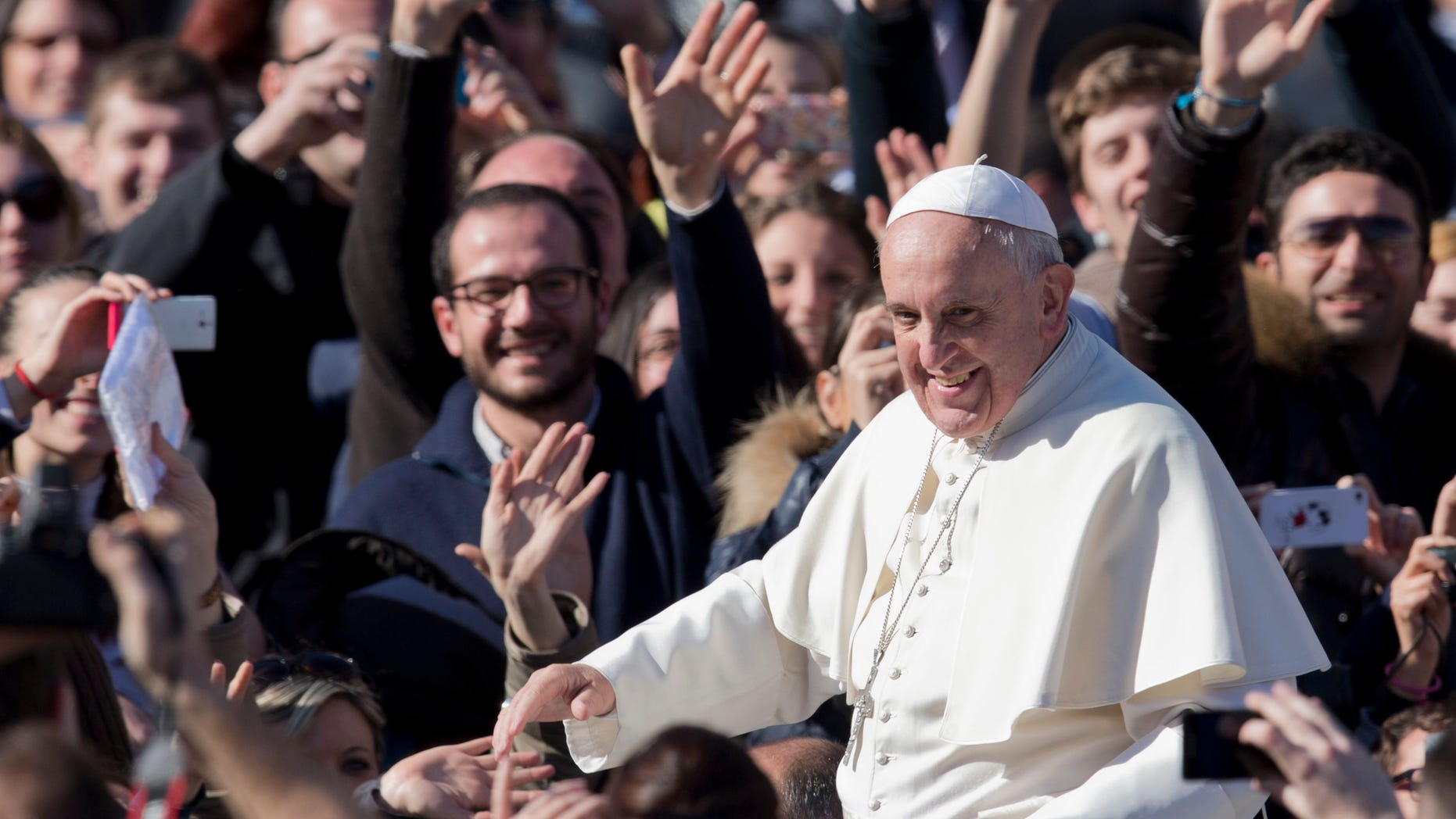 Pope Francis greets faithful as he leaves  St. Peter's Square at the Vatican, Friday, Feb. 14, 2014. Pope Francis met a group of engaged couples on Valentine's Day. (AP)