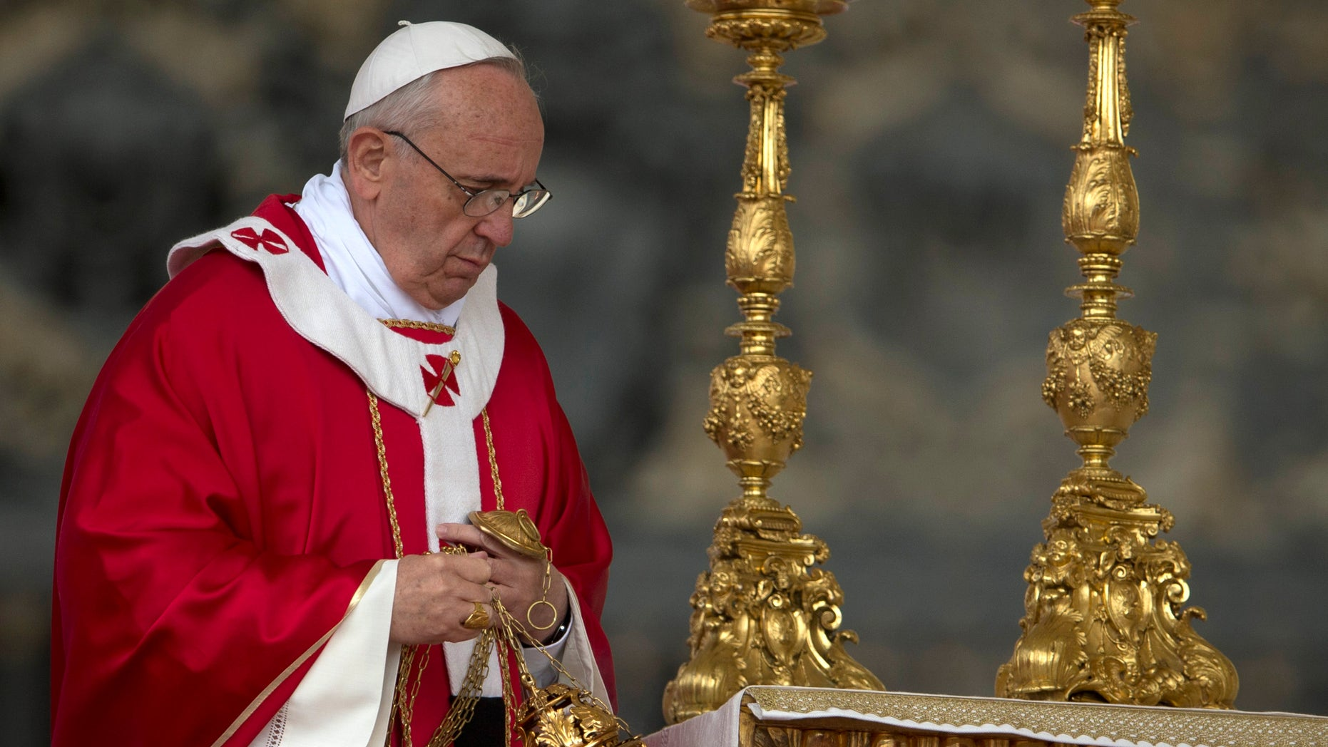 Pope Francis celebrates a Pentecost mass in St. Peter's Square at the Vatican, Sunday, May 19, 2013.( (AP Photo/Andrew Medichini)