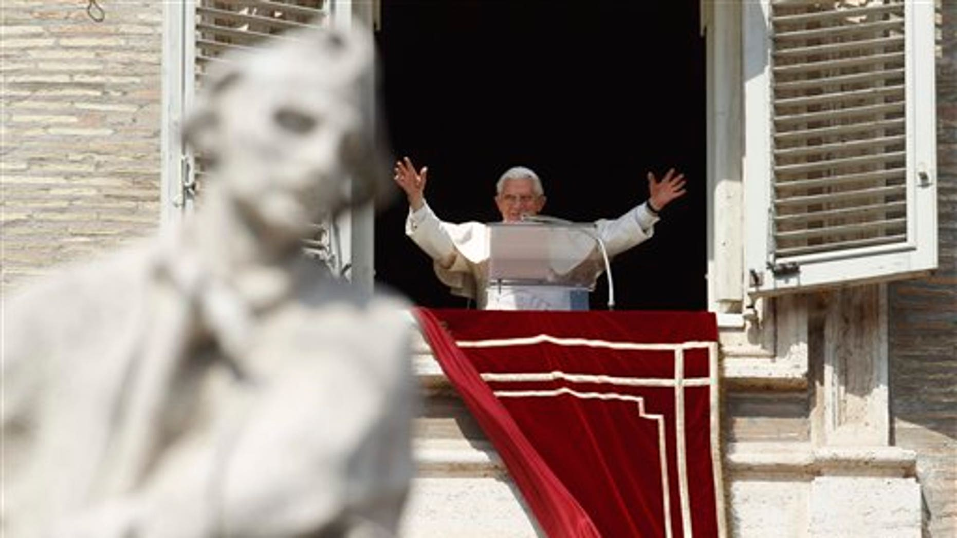 March 18: Pope Benedict XVI greets faithful during the Angelus prayer from his studio window overlooking St. Peter's Square at the Vatican. Pope Benedict XVI has asked for prayers for his upcoming trip to Mexico and Cuba.