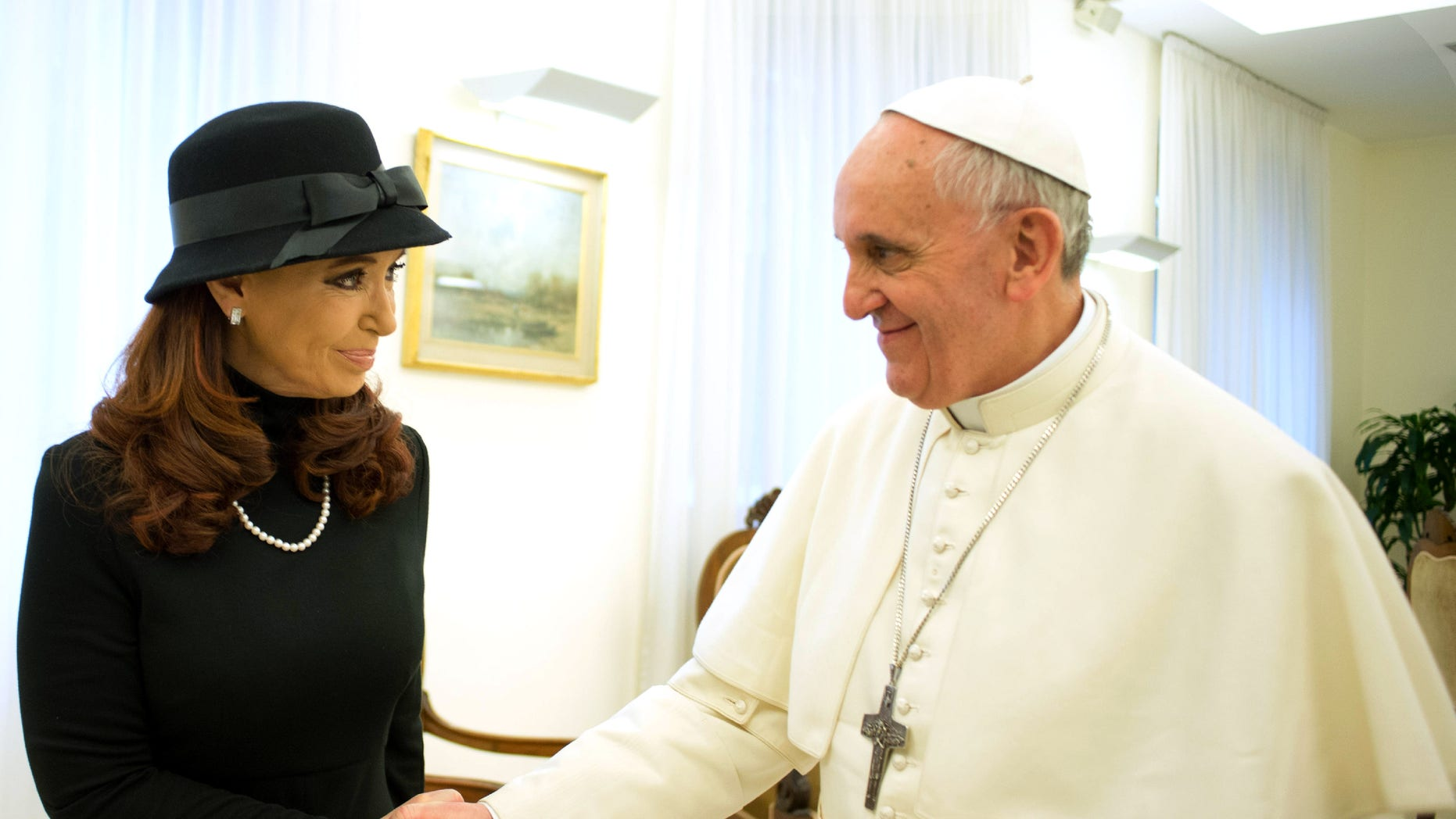 In this photo provided by the Vatican paper L'Osservatore Romano, Pope Francis meets Argentine President Cristina Fernandez at the Vatican, Monday, March 18, 2013.