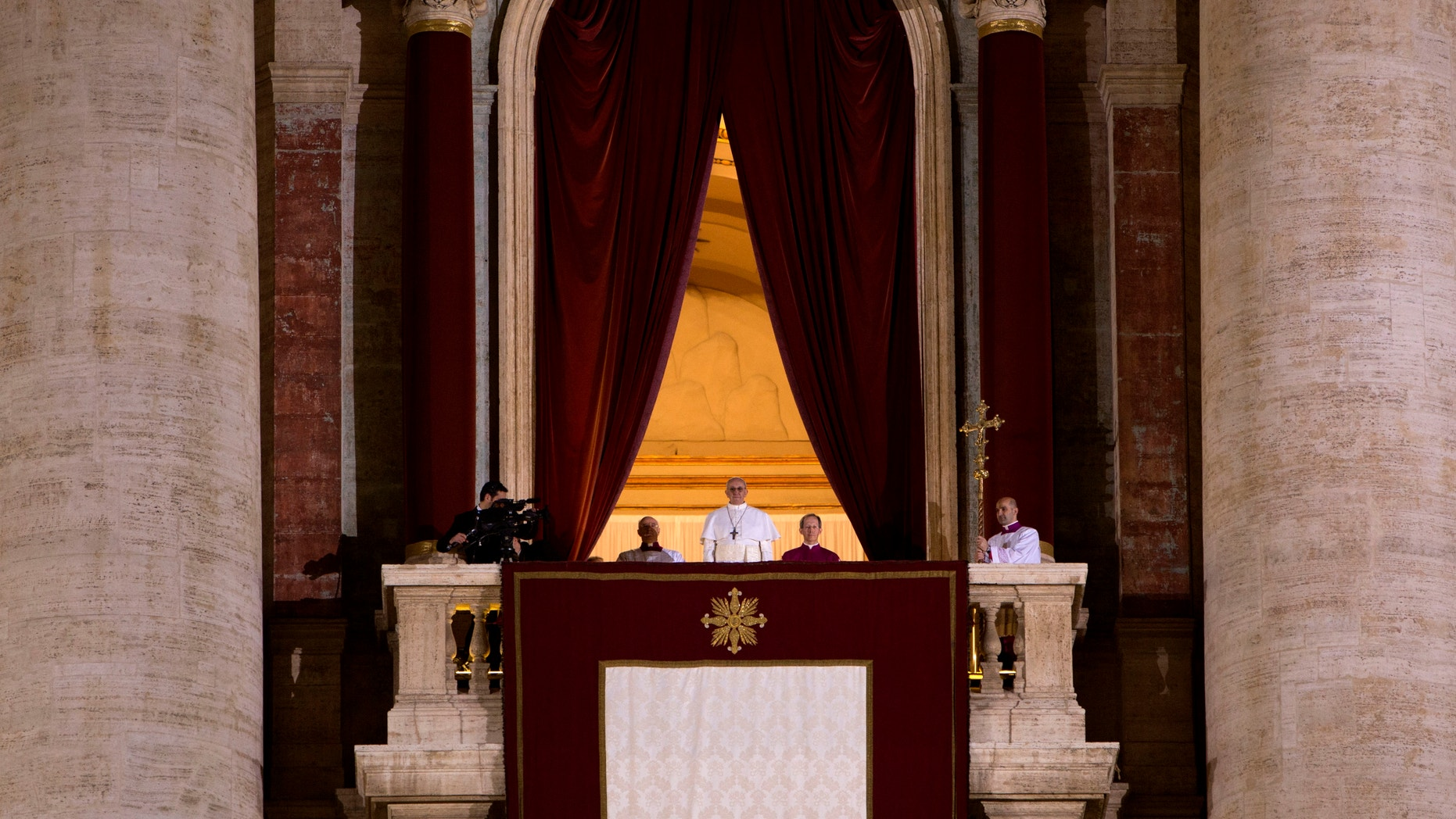 March 13, 2013 - Pope Francis, white figure at center of the balcony of St. Peter's Basilica, looks at the crowd in St. Peter's Square, at the Vatican.