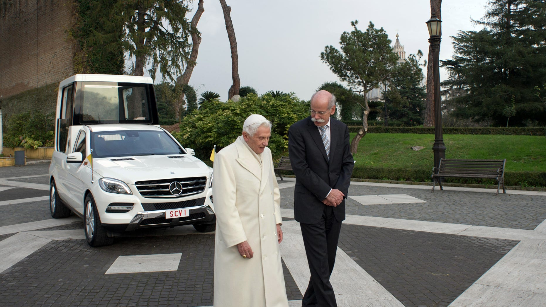 Dec. 7, 2012 - Pope Benedict XVI and Mercedes Benz CEO Dieter Zetsche walk past the new popemobile presented to the Pontiff at the Vatican.