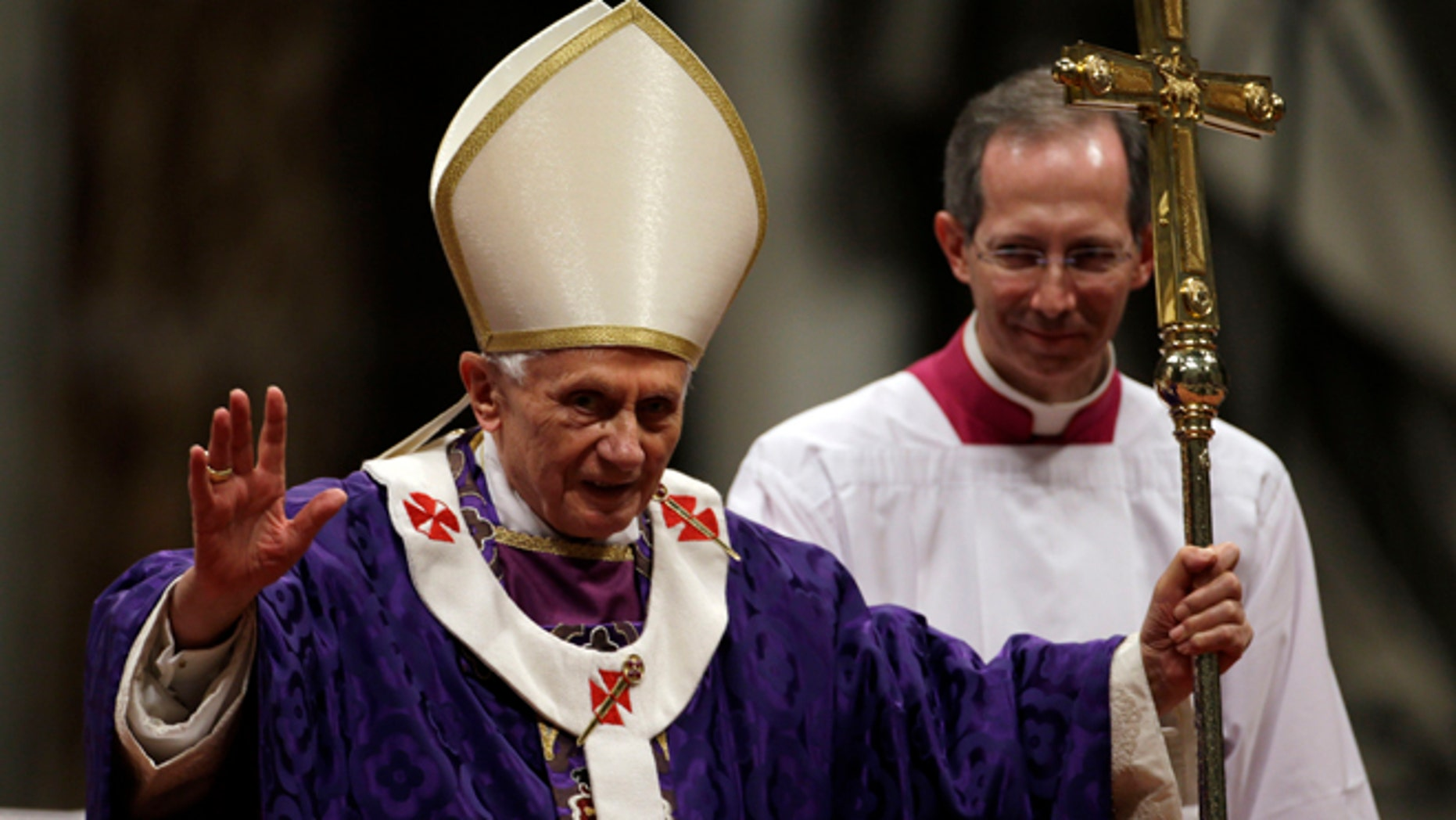 Feb. 13, 2013: Pope Benedict XVI greets the faithful at the end of the Ash Wednesday mass in St. Peter's Basilica at the Vatican.