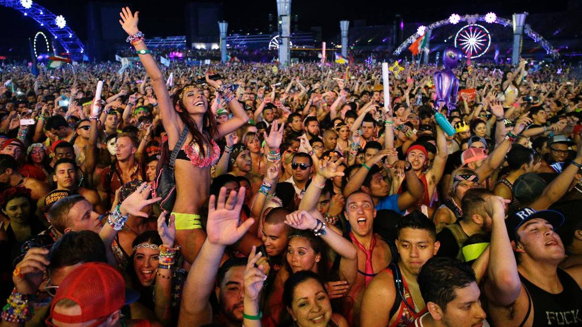 FILE -Carnival goers dance to music by Krewella at the Electric Daisy Carnival in Las Vegas.