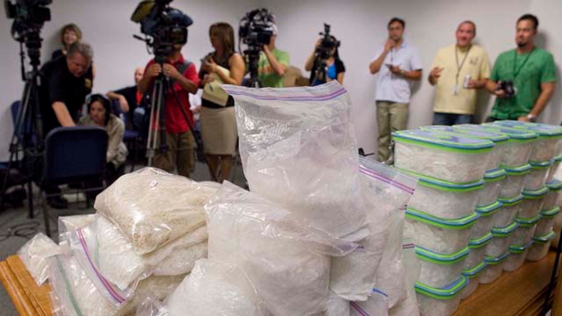 Containers of different forms of methamphetamine are displayed at a news conference announcing the state's largest meth bust in history, Thursday, July 14, 2011, in Las Vegas. Law enforcement agencies from Las Vegas, Henderson and Boulder City seized 200 pounds of the drug earlier in the week. (AP Photo/Julie Jacobson)