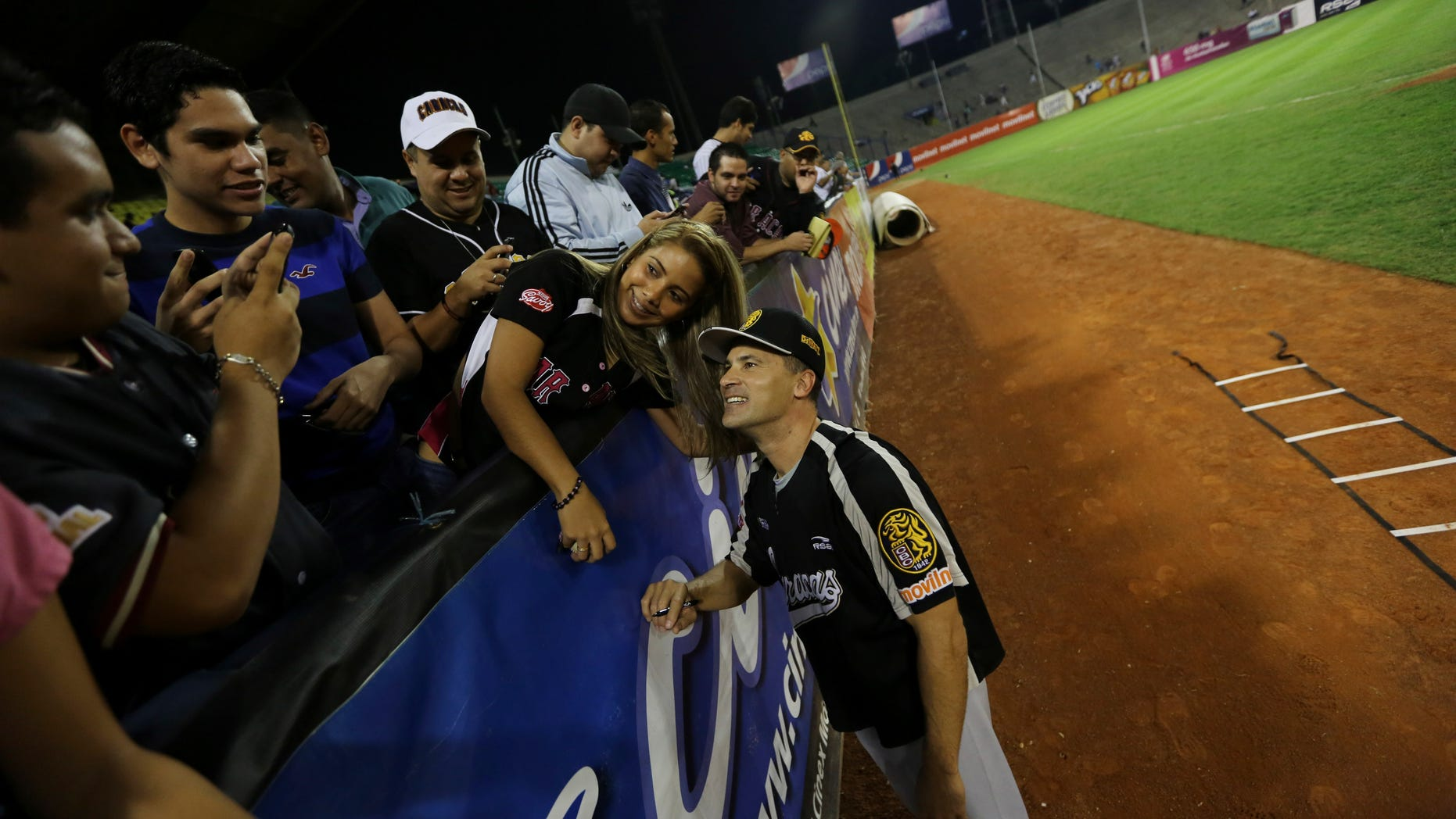 Omar Vizquel, former Cleveland Indians shortstop, poses for a photo with fans on Nov. 27, 2013 in Caracas, Venezuela.