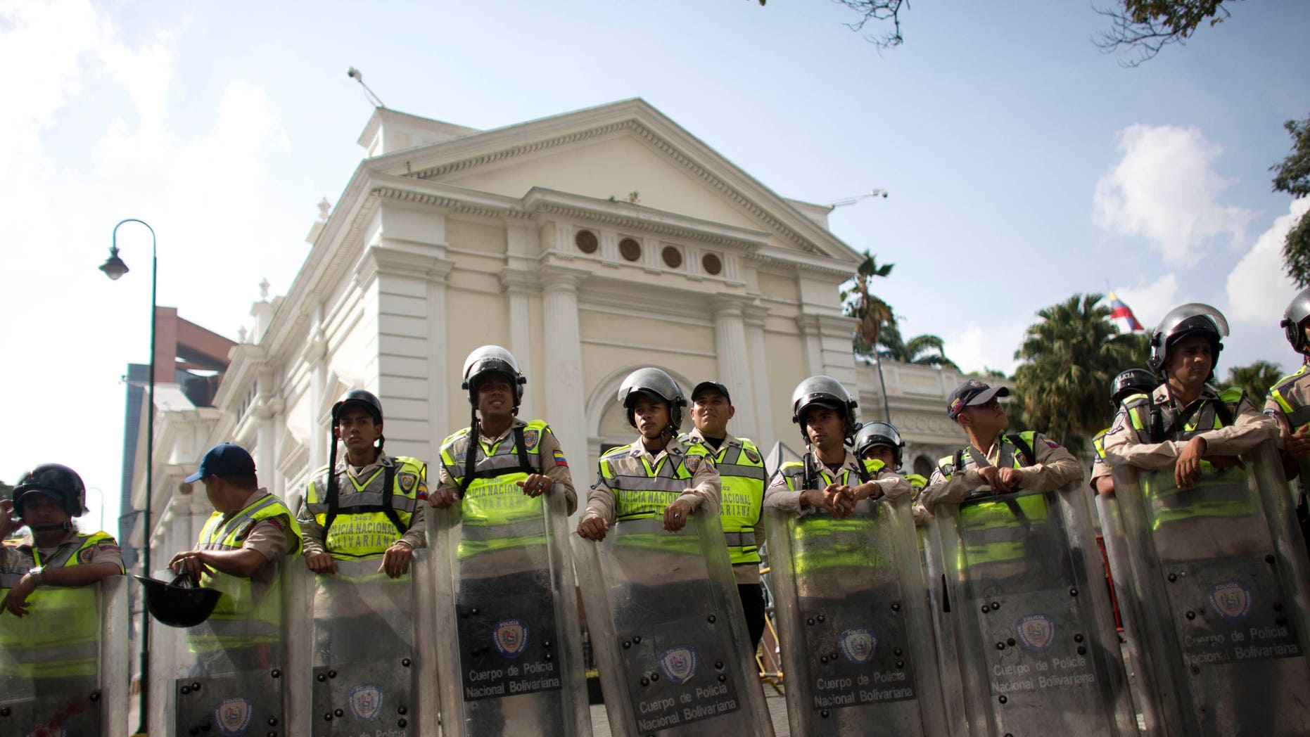 National Bolivarian Police officers outside the National Assembly building in Caracas, Venezuela, Tuesday, March. 1, 2016.