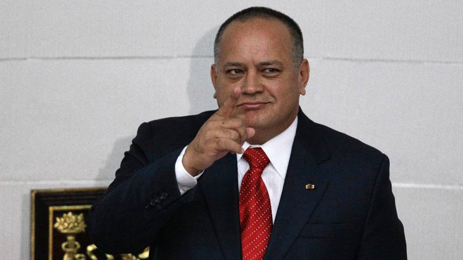 FILE - In this Jan. 5, 2013, file photo, National Assembly President Diosdado Cabello gestures before addressing the National Assembly in Caracas, Venezuela. The powerful head of Venezuela's congress moved Wednesday, Jan. 28, 2015, to distance himself from a bodyguard who defected to the United States and reportedly has implicated his former boss as head of drug ring of political and military officials. (AP Photo/Ariana Cubillos, File)