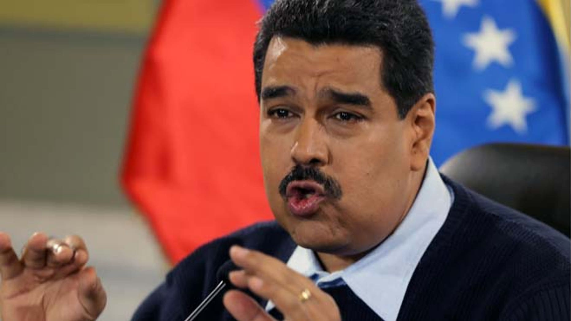 FILE - In this Aug. 24, 2015 file photo, Venezuela's President Nicolas Maduro gives a news conference at Miraflores presidential palace in Caracas, Venezuela. On Sunday, Oct. 18, 2015, Maduro called for prosecution of Lorenzo Mendoza, Venezuelaâs biggest businessman, president of the Empresas Polar conglomerate, for allegedly conspiring to destabilize his government. (AP Photo/Fernando Llano, File)