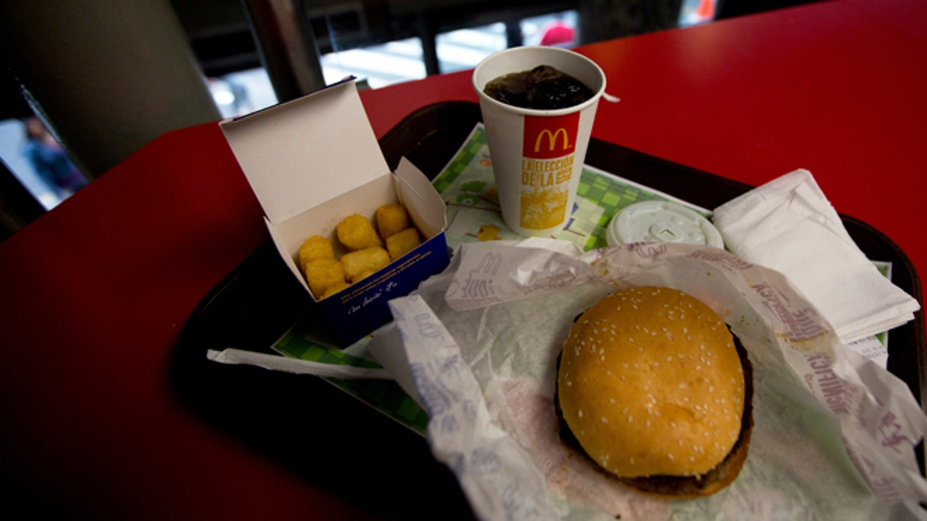 A Quarter Pounder meal is served with arepas or corn cakes at a local McDonald's, in Caracas, Venezuela, Tuesday, Jan. 6, 2015. McDonalds franchises in Venezuela have run out of potatoes and are now serving South American alternatives like deep-fried arepas or yuca, a starchy tuberous root. The franchisers are blaming a contract dispute with West Coast dock workers for halting the export of frozen fries to the country. (AP Photo/Fernando Llano)